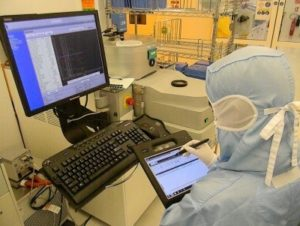 An operator using Check'n Go software, in Tronics Microsystems company